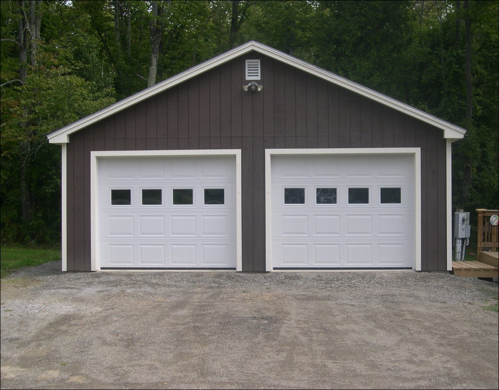 Cost to build two car garage swopes garage for Double garage cost